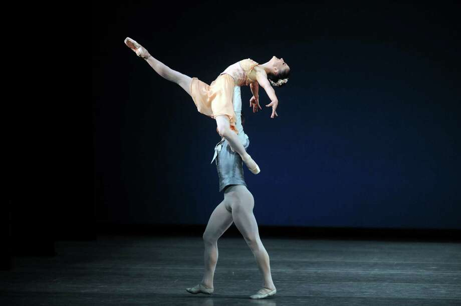 Dancers Ashley Bouder and Gonzalo Garcia perform the Tschaikovsky Pas De Deux during the New York City Ballet's opening night at SPAC on Tuesday July 9, 2013 in Saratoga Springs, N.Y. (Michael P. Farrell/Times Union) Photo: Michael P. Farrell / 00023097A