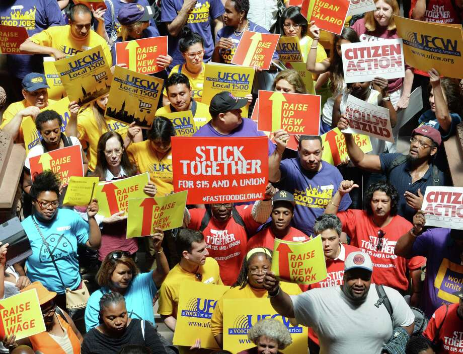 Minimum wage protesters fill the western staircase of the Capitol Tuesday, June 17, 2014, in Albany, N.Y.  (John Carl D'Annibale / Times Union) Photo: John Carl D'Annibale / 00027383A