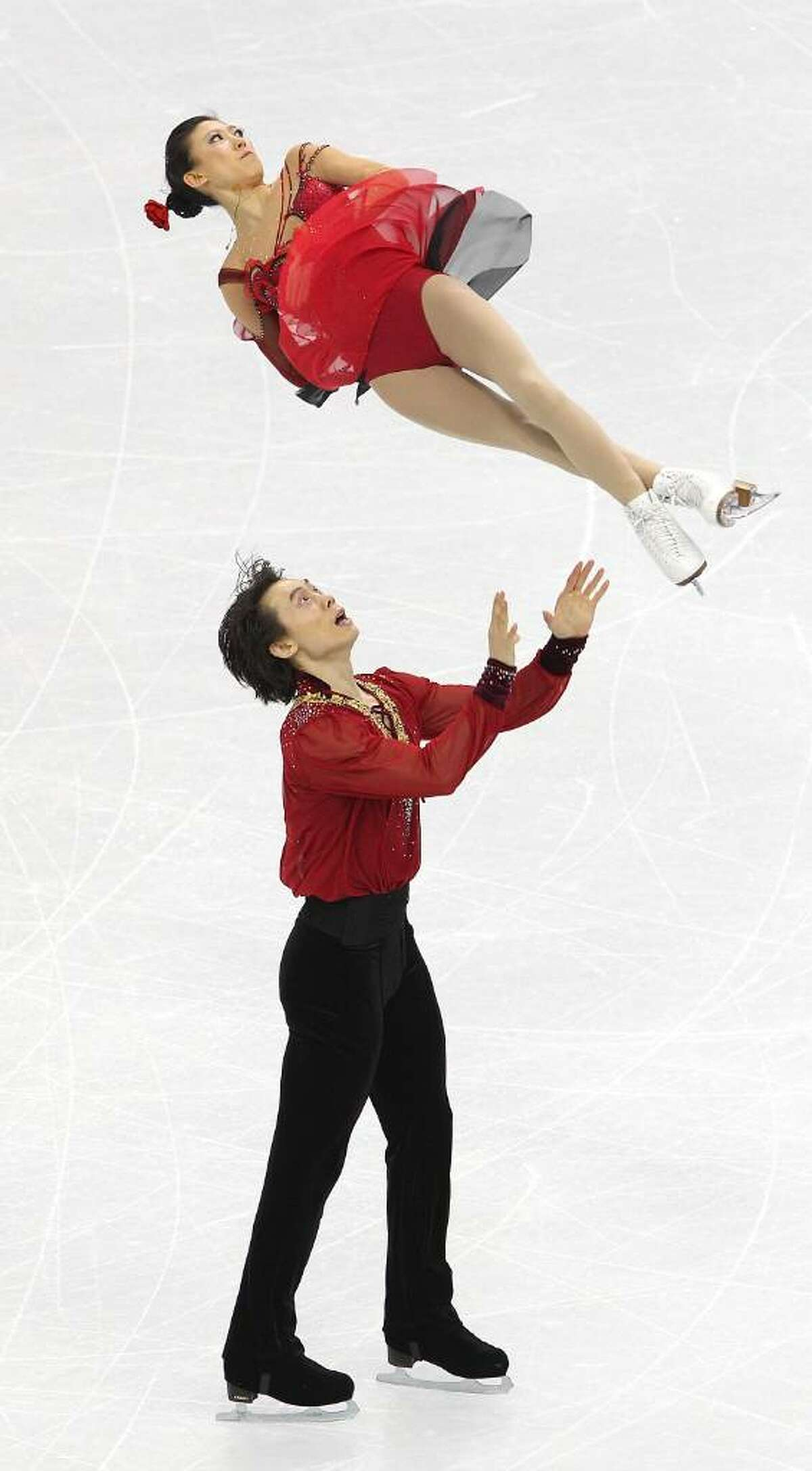 VANCOUVER, BC - FEBRUARY 15: Qing Pang and Jian Tong of China compete in the Figure Skating Pairs Free Program on day 4 of the Vancouver 2010 Winter Olympics at the Pacific Coliseum on February 15, 2010 in Vancouver, Canada. (Photo by Cameron Spencer/Getty Images) *** Local Caption *** Qing Pang;Jian Tong