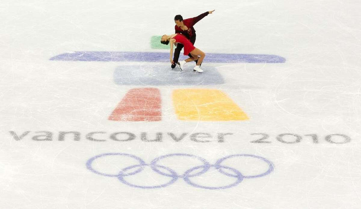 VANCOUVER, BC - FEBRUARY 15: Xue Shen and Hongbo Zhao of China compete in the Figure Skating Pairs Free Program on day 4 of the Vancouver 2010 Winter Olympics at the Pacific Coliseum on February 15, 2010 in Vancouver, Canada. (Photo by Cameron Spencer/Getty Images) *** Local Caption *** Xue Shen;Hongbo Zhao