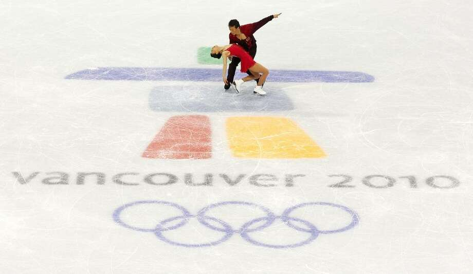 VANCOUVER, BC - FEBRUARY 15:  Xue Shen and Hongbo Zhao of China compete in the Figure Skating Pairs Free Program on day 4 of the Vancouver 2010 Winter Olympics at the Pacific Coliseum on February 15, 2010 in Vancouver, Canada.  (Photo by Cameron Spencer/Getty Images) *** Local Caption *** Xue Shen;Hongbo Zhao Photo: Cameron Spencer, Getty Images / 2010 Getty Images