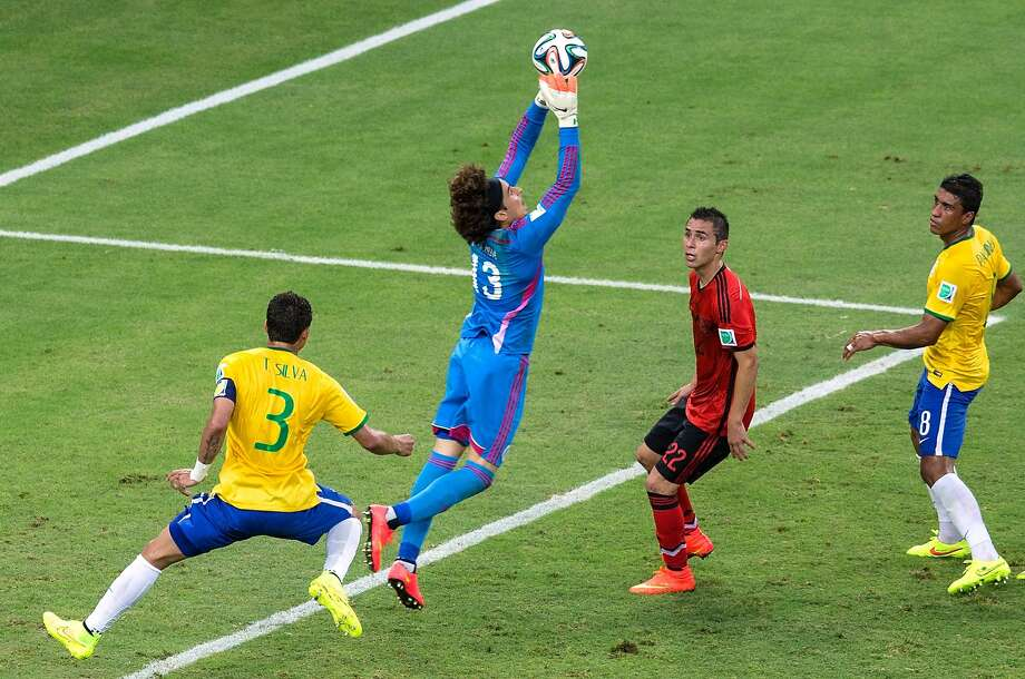 Guillermo Ochoa, Mexico's goalkeeper, makes a save during El Tri's more-exciting-than-the-score-would-indicate 0-0 draw with Brazil. Photo: Miguel Tovar, Getty Images
