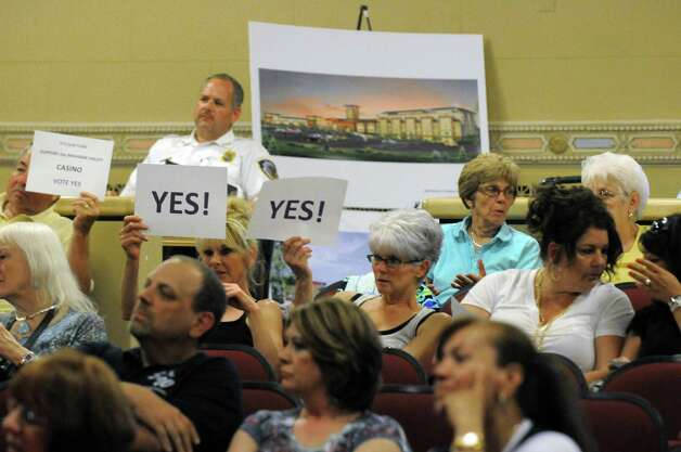 Residents listen as the Amsterdam Common Council votes on a Exit 27 casino proposal Tuesday June 17, 2014 in Amsterdam, N.Y.  (Michael P. Farrell/Times Union) Photo: Michael P. Farrell / 00027397A