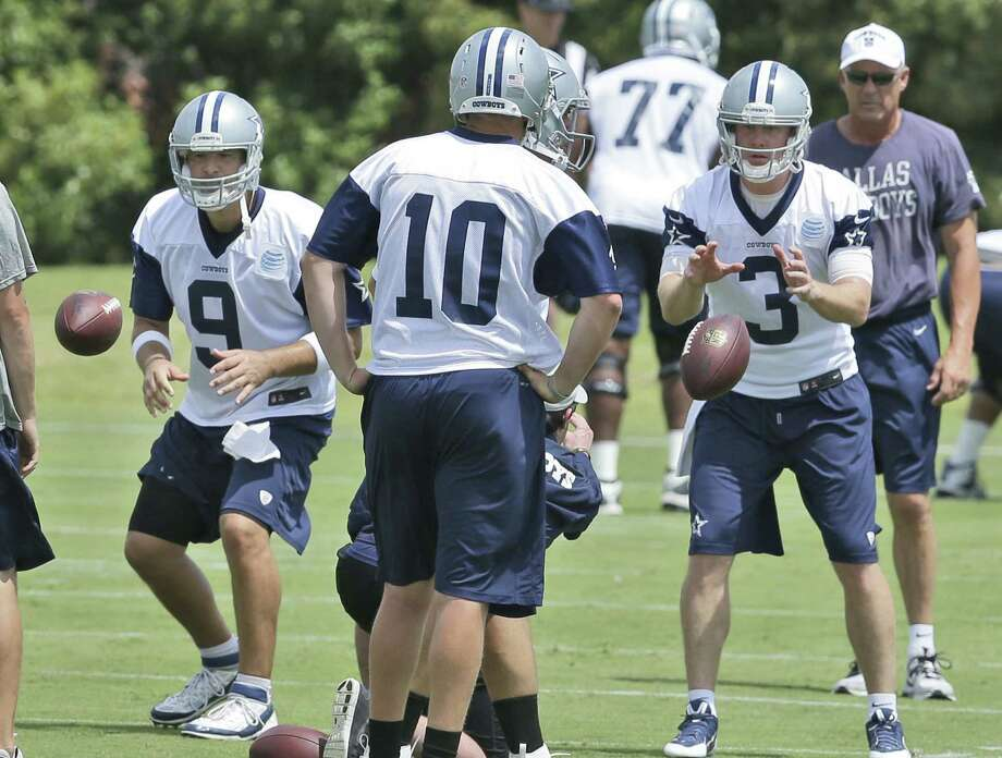 Cowboys QBs Tony Romo (left) and Brandon Weeden (right) take snaps at minicamp. Romo is recovering from back surgery, and Weeden is the de facto starter in the absence of Kyle Orton. Photo: L.M. Otero / Associated Press / AP