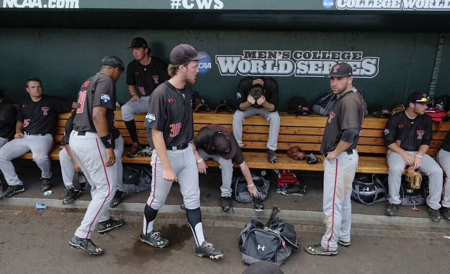 Texas Tech players mill around the dugout after losing to Mississippi. The Red Raiders went 0-2 in their first trip to the College World Series, falling to the Rebels and TCU in Omaha. Photo: Eric Francis / Associated Press / FR9944 AP