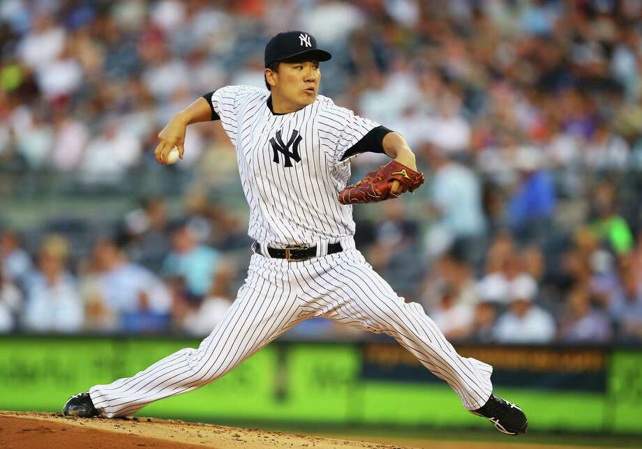 NEW YORK, NY - JUNE 17:  Masahiro Tanaka #19 of the New York Yankees pitches against the Toronto Blue Jays in the first inning during their game at Yankee Stadium on June 17, 2014 in the Bronx borough of New York City.  (Photo by Al Bello/Getty Images) ORG XMIT: 477585143 Photo: Al Bello / 2014 Getty Images