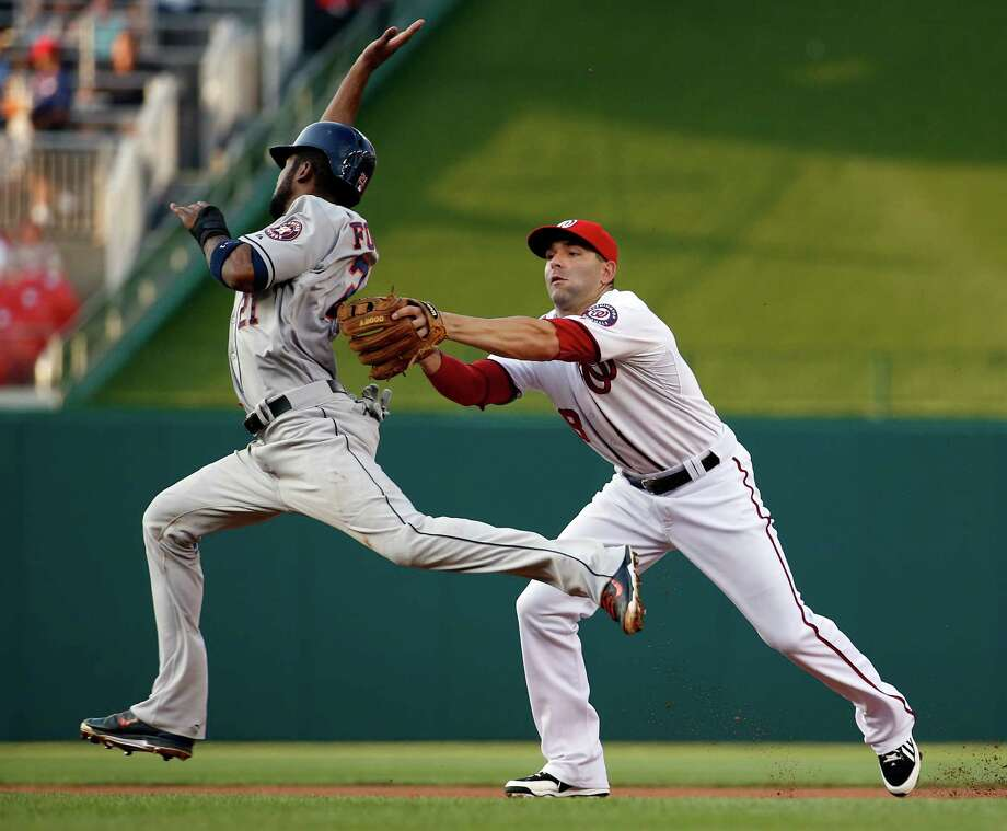 Dexter Fowler fails in his bid to avoid the tag by Nationals second baseman Danny Espinosa on a Jose Altuve grounder that turned into a double play. Photo: Alex Brandon, STF / AP