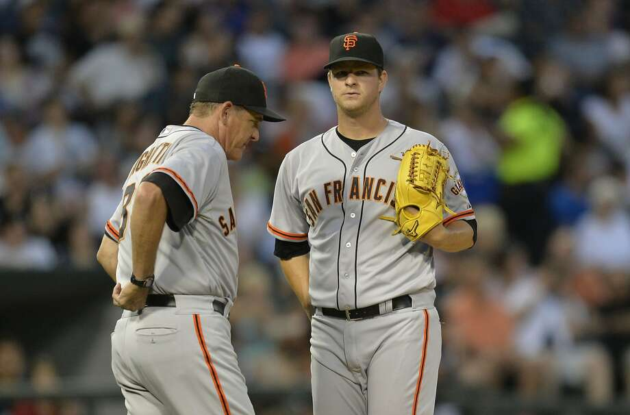 Dave Righetti (left) talks with Matt Cain during the fourth inning, when the White Sox sent eight men to the plate. Photo: Brian Kersey, Getty Images