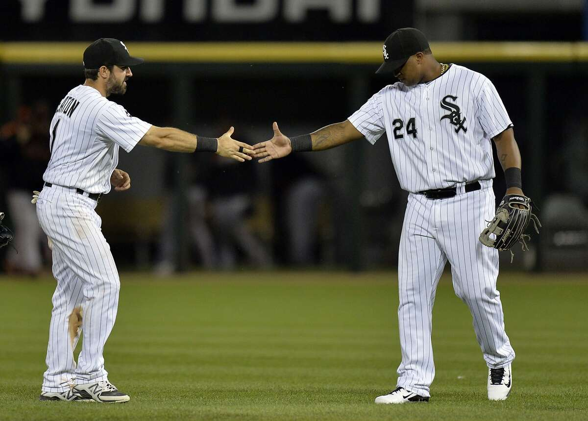 CHICAGO, IL - JUNE 17: Adam Eaton #1 (L) and Dayan Viciedo #24 of the Chicago White Sox celebrate their 8-2 win over the San Francisco Giants at U.S. Cellular Field on June 17, 2014 in Chicago, Illinois. (Photo by Brian Kersey/Getty Images)