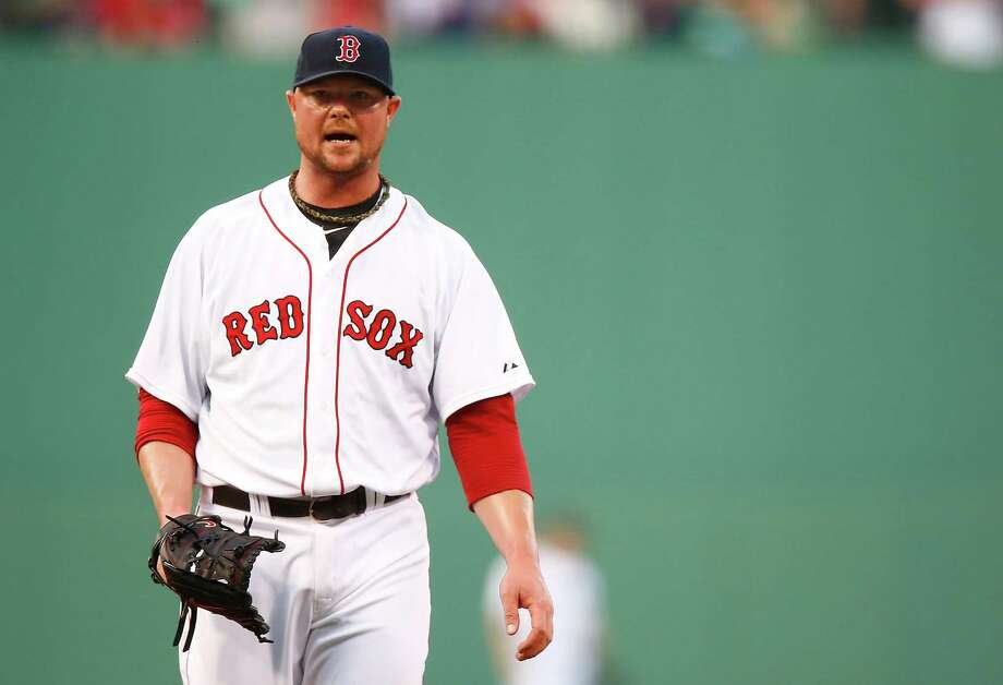 BOSTON, MA - JUNE 17:  Jon Lester #31 of the Boston Red Sox yells in between pitches in the first inning against the Minnesota Twins in the first inning during the game at Fenway Park on June 17, 2014 in Boston, Massachusetts.  (Photo by Jared Wickerham/Getty Images) ORG XMIT: 477585139 Photo: Jared Wickerham / 2014 Getty Images