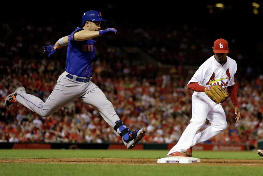 St. Louis Cardinals relief pitcher Sam Freeman, right, tags the bag to force New York Mets' David Wright out at first base during the eighth inning of a baseball game Tuesday, June 17, 2014, in St. Louis. (AP Photo/Jeff Roberson) ORG XMIT: MOJR117 Photo: Jeff Roberson / AP