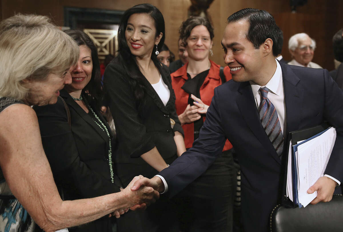 Mayor Julián Castro is congratulated after his confirmation hearing before the Senate Banking, Housing and Urban Affairs Committee.