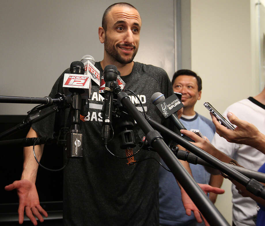 Manu Ginobili, sporting a new buzz cut (above), and Patty Mills, showing off a 2014 NBA championship cap (below), talk with the news media as the Spurs cleaned out their lockers. Photo: Photos By Jerry Lara / San Antonio Express-News / © 2014 San Antonio Express-News