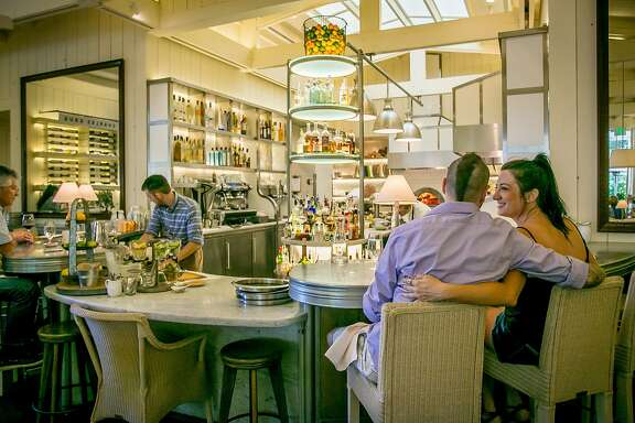 A couple has drinks at the bar during happy hour at Archetype in St. Helena,  Calif., on Tuesday, June 10th, 2014.