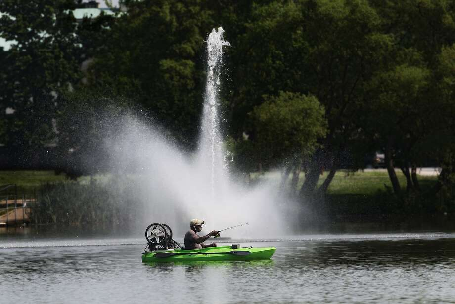 A fisherman took his kayak to the lake in FDR park in South Philadelphia on Tuesday, June 17, 2014. (AP Photo/The Philadelphia Inquirer, Michael Bryant ) Photo: Michael Bryant, Associated Press