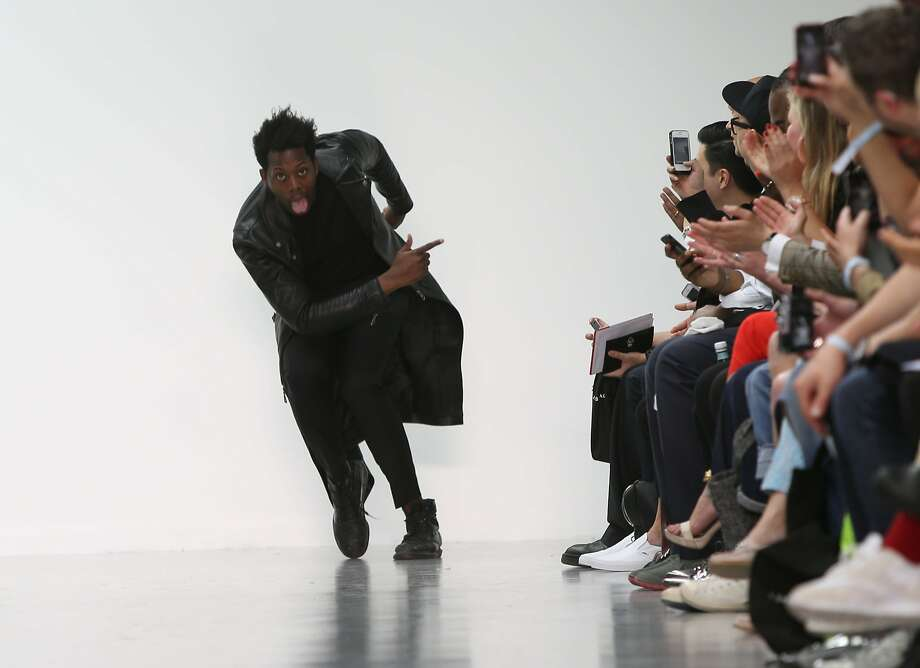 British fashion designer Nasir Mazhar takes the applause following London Men's spring summer fashion collections 2015, at Victoria House, central London, Tuesday, June 17, 2014. (Photo by Joel Ryan/Invision/AP) Photo: Photo By Joel Ryan/Invision/AP, Associated Press