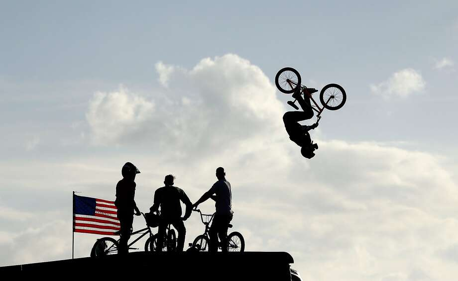 AUSTIN, TX - JUNE 07:  Riders watch as Steve McCann of Australia warms up for the BMX Big Air Finals during the X Games Austin at Circuit of The Americas on June 7, 2014 in Austin, Texas.  (Photo by Ezra Shaw/Getty Images) Photo: Ezra Shaw, Getty Images