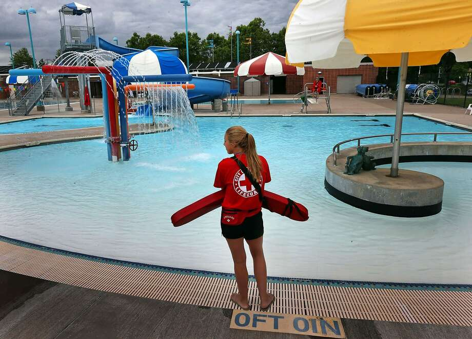 Lifeguard Makayla Pestrikoff, 16, stands by the pool as Amazon Pool in Eugene, Ore., opens for the season Tuesday, June 17, 2014. (AP Photo/The Register-Guard, Chris Pietsch) Photo: Chris Pietsch, Associated Press