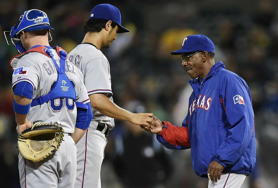 OAKLAND, CA - JUNE 17:  Manager Ron Washington #38 of the Texas Rangers takes pitcher Yu Darvish #11 out of the game in the bottom of the sixth inning against the Oakland Athletics at O.co Coliseum on June 17, 2014 in Oakland, California.  (Photo by Thearon W. Henderson/Getty Images) Photo: Thearon W. Henderson, Getty Images