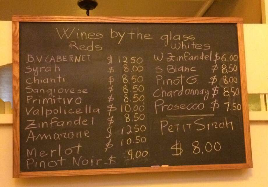 Close up of the  by-the-glass board; who needs the producer? Only varietals are listed.