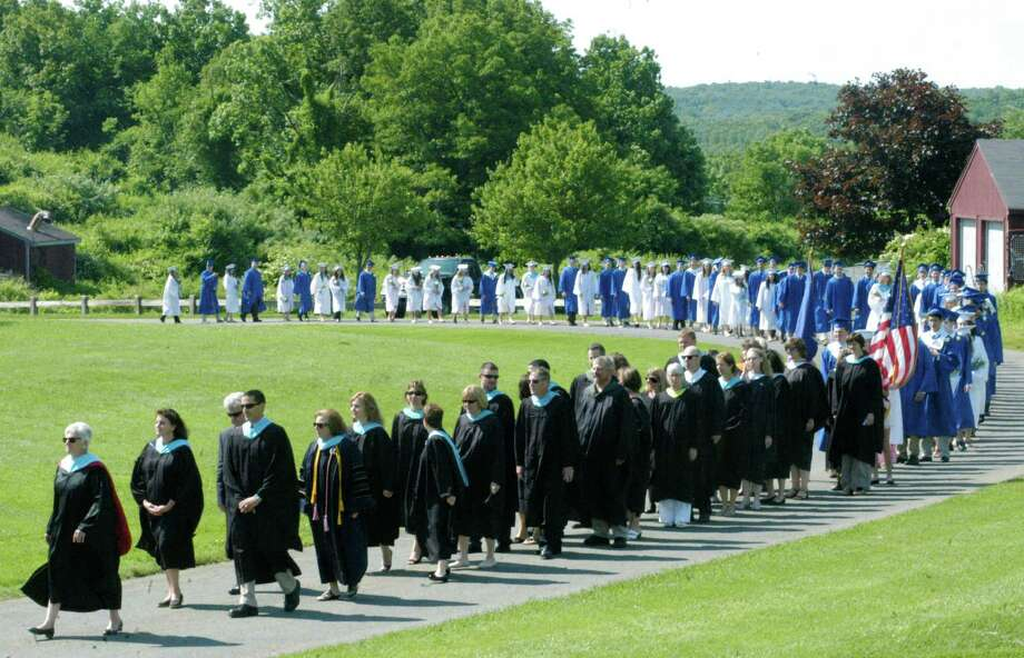 Principal Kim Gallo shiows the way for school faculty and 76 soon-to-be graduates during the processional for the Shepaug Valley High School graduation ceremony, June 14, 2014, on the school campus in Washington. Photo: Norm Cummings / The News-Times