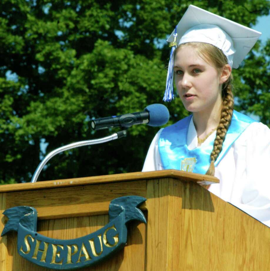 Dana Walker offers her salutatory address during the Shepaug Valley High School graduation ceremony, June 14, 2014, on the school campus in Washington. Photo: Norm Cummings / The News-Times