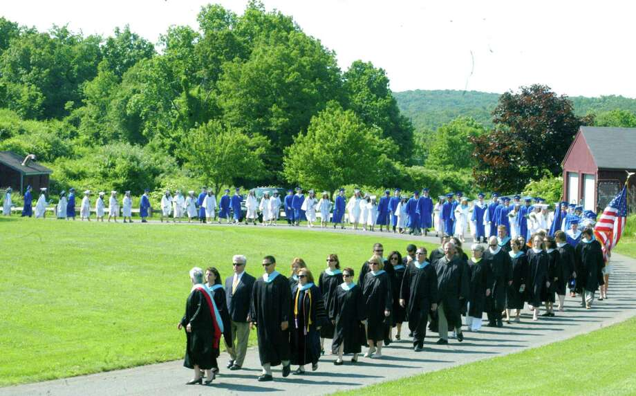 Principal Kim Gallo checks back just to be sure everyone's still with her as she leads the procession for the Shepaug Valley High School graduation ceremony, June 14, 2014, on the school campus in Washington. Photo: Norm Cummings / The News-Times