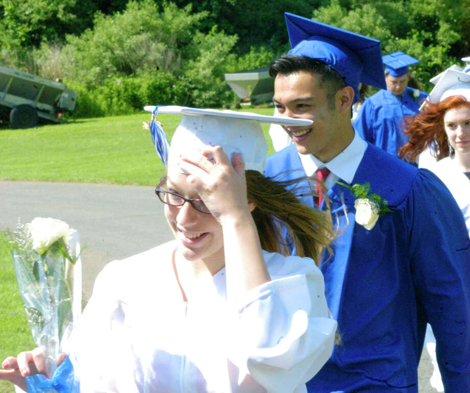 Brittany Waldron, Jordan Walker and Larissa Walsh sport various degrees of smiles as they experience the processional for the Shepaug Valley High School graduation ceremony, June 14, 2014, on the school campus in Washington. Photo: Norm Cummings / The News-Times