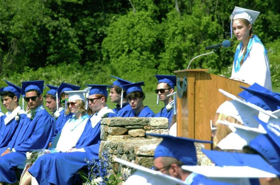 Dana Walker delivers her salulatory address during the Shepaug Valley High School graduation ceremony, June 14, 2014, on the school campus in Washington. Photo: Norm Cummings / The News-Times