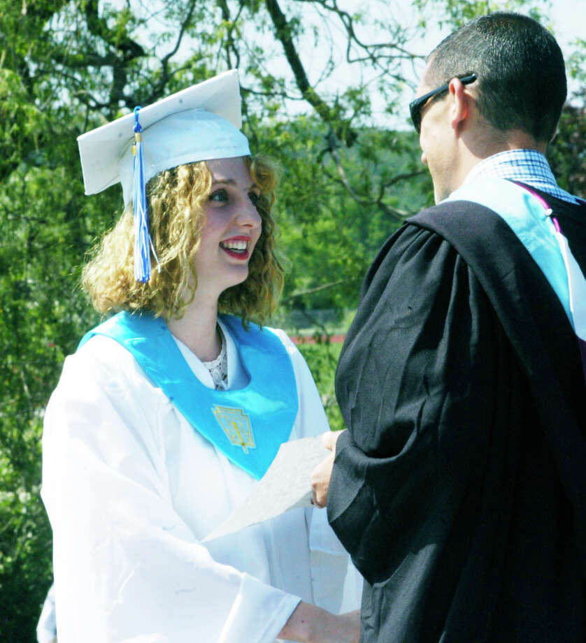 Caroline Hermans receives the school's community service award from assistant principal Matt Perachi during the Shepaug Valley High School graduation ceremony, June 14, 2014, on the school campus in Washington. Photo: Norm Cummings / The News-Times