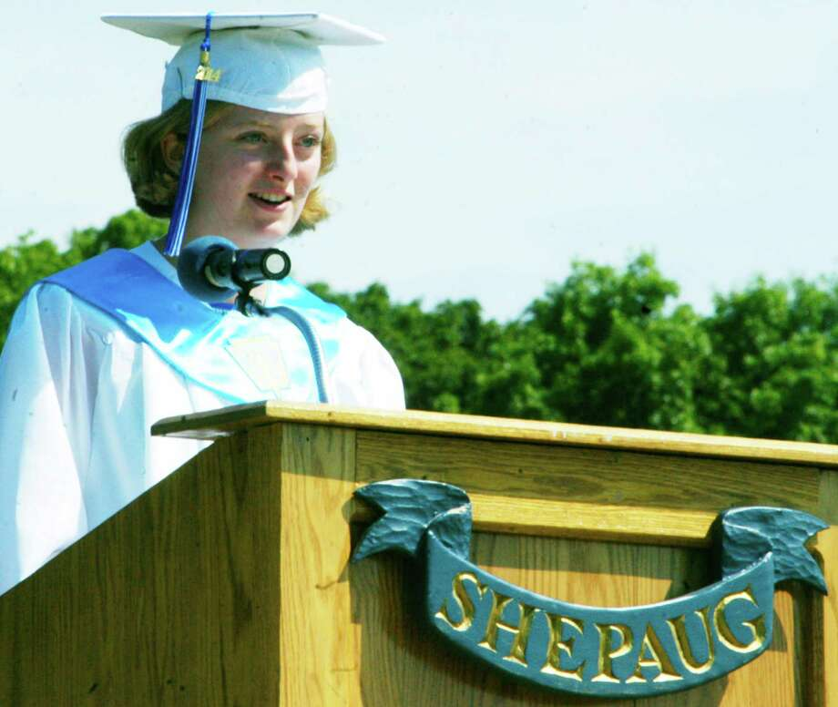 Valedictorian Clara Wolfe delivers her address to classmates, families and friends during the Shepaug Valley High School graduation ceremony, June 14, 2014, on the school campus in Washington. Photo: Norm Cummings / The News-Times