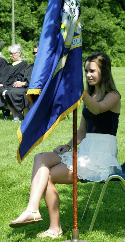 Junior Marshal Molly Mercier with the state flag during the Shepaug Valley High School graduation ceremony, June 14, 2014, on the school campus in Washington. Photo: Norm Cummings / The News-Times