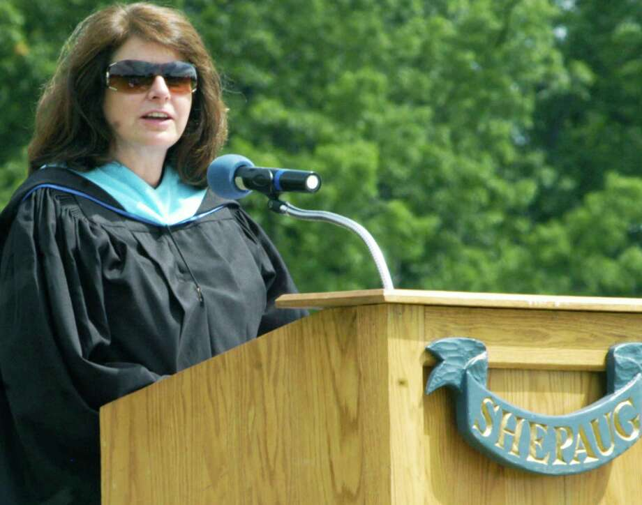 Assistant principal Lori Ferreira congratulates the graduates on their strong performance in their senior projects during the Shepaug Valley High School graduation ceremony, June 14, 2014, on the school campus in Washington. Photo: Norm Cummings / The News-Times