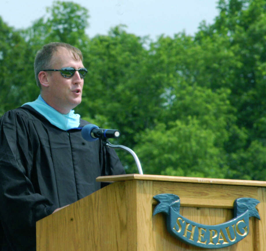 His shades reflecting the scene before him, faculty member Jim Stinson offers his reflections on the Class of 2014 during the Shepaug Valley High School graduation ceremony, June 14, 2014, on the school campus in Washington. Photo: Norm Cummings / The News-Times