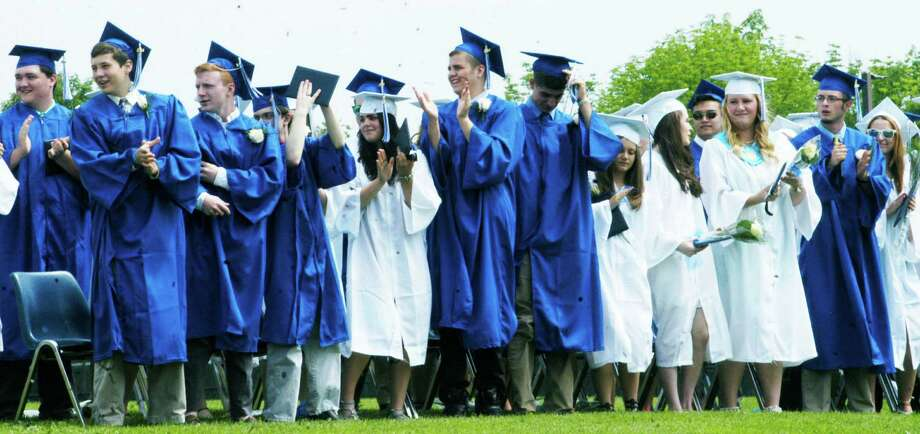The graduates offer a standing ovation for faculty member Jim Stinson during the Shepaug Valley High School graduation ceremony as a show of appreciation for what he's done for the class, June 14, 2014, on the school campus in Washington. Photo: Norm Cummings / The News-Times