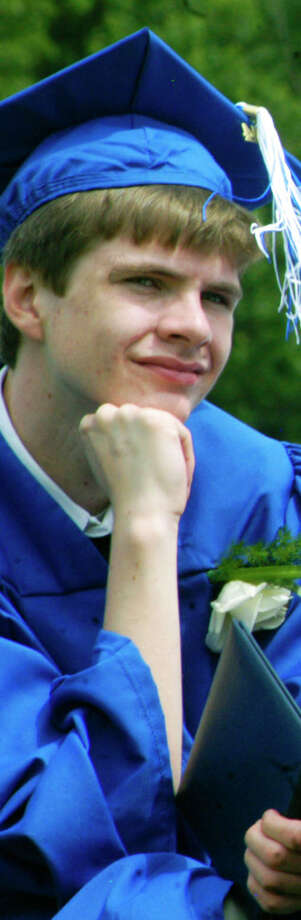 Evan Leary perhaps ponders what opportunities lay ahead as he experiences the Shepaug Valley High School graduation ceremony, June 14, 2014, on the school campus in Washington. Photo: Norm Cummings / The News-Times