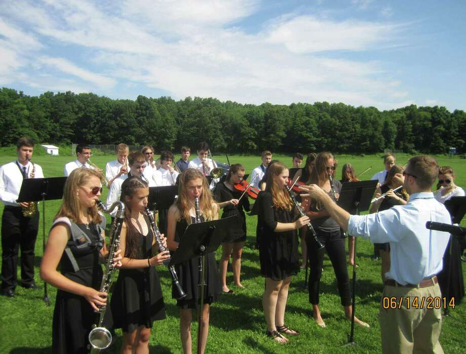 Members of the school orchestra perform during the Shepaug Valley High School commencement ceremony, Jne 14, 2014, on the school campus in Washington. Photo: Norm Cummings / The News-Times
