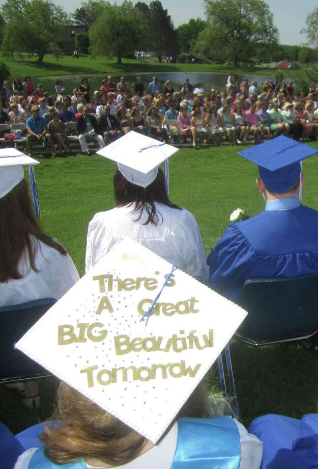 "Soon-to-be graduate Sarah Williams delivers an optimistic message on her hat: ""There's a great, big, beautiful tomorrow,"" during the Shepaug Valley High School commencement ceremony, Jne 14, 2014, on the school campus in Washington. Photo: Norm Cummings / The News-Times"