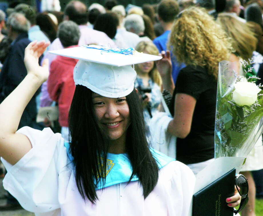 Emily Chin is a happy graduate as she strolls the recessional after the Shepaug Valley High School commencement ceremony, Jne 14, 2014, on the school campus in Washington. Photo: Norm Cummings / The News-Times