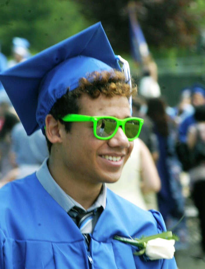 David Geyer's easy smile is even broader than usual during the recessional for the Shepaug Valley High School commencement ceremony, Jne 14, 2014, on the school campus in Washington. Photo: Norm Cummings / The News-Times
