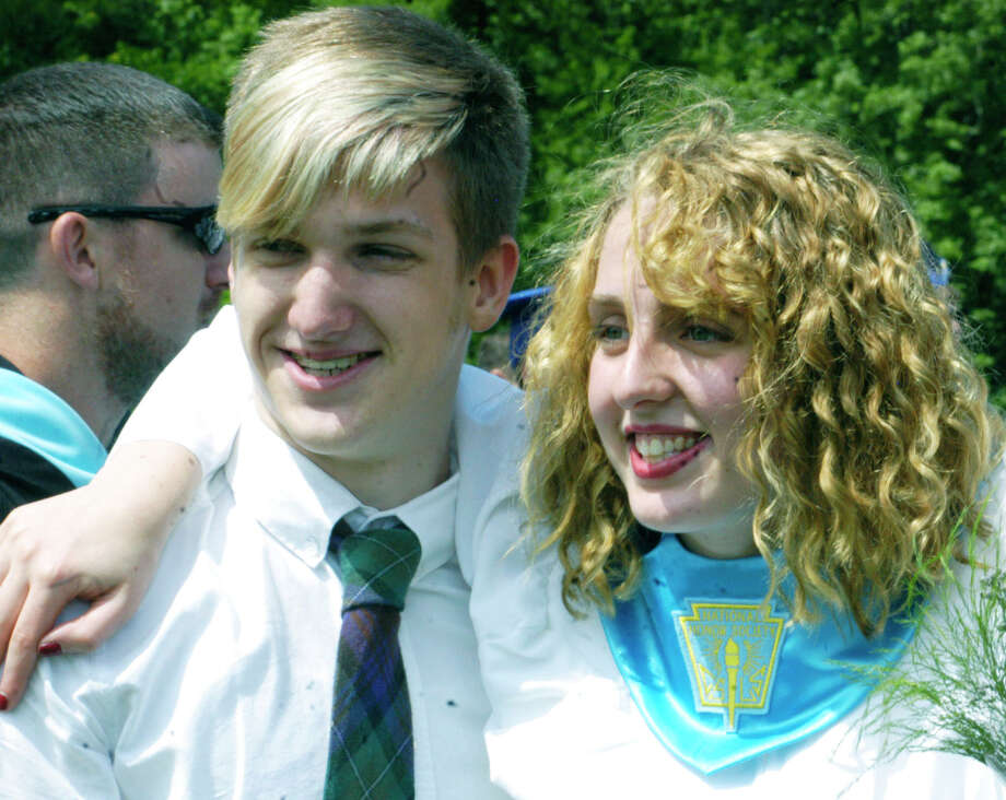 Graduate Caroline Herman sstrikes a pose with friend Sebastian Taylor, a rising Shepaug senior, following the Shepaug Valley High School commencement ceremony, Jne 14, 2014, on the school campus in Washington. Photo: Norm Cummings / The News-Times