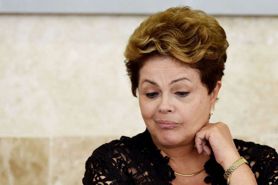 Brazilian President Dilma Rousseff said in a March statement that the Petroleo Brasileiro SA board she headed in 2006 approved the initial stake in the Texas refinery without knowledge of the option that allowed Astra to force the sale of its remaining share to Petrobras. Photo: Evaristo Sa, AFP Via Getty Images