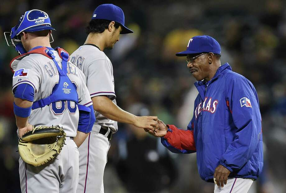 OAKLAND, CA - JUNE 17:  Manager Ron Washington #38 of the Texas Rangers takes pitcher Yu Darvish #11 out of the game in the bottom of the sixth inning against the Oakland Athletics at O.co Coliseum on June 17, 2014 in Oakland, California. Photo: Thearon W. Henderson, Getty Images / 2014 Getty Images