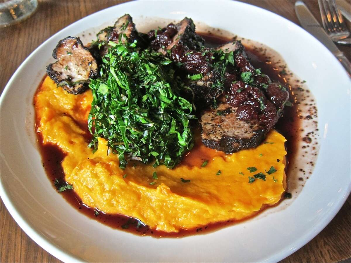Coffee-crusted pork tenderloin with port-cherry reduction, whipped sweet potatoes and collards at Dish Society.