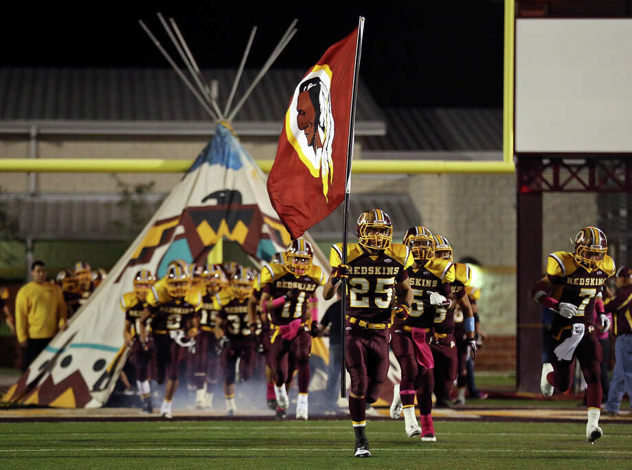 Members of the Donna Redskins football team take the field against the Sharyland Rattlers Friday Oct. 18, 2013 at Bennie La Parade Stadium in Donna, Tx. Sharyland won 47-20. Photo: San Antonio Express-News / © 2013 San Antonio Express-News