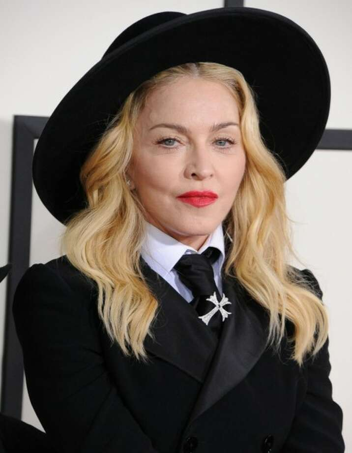 Madonna reportedly spends $10,000 a month on a special Kabbalah water with healing powers. - celebritytoob.com