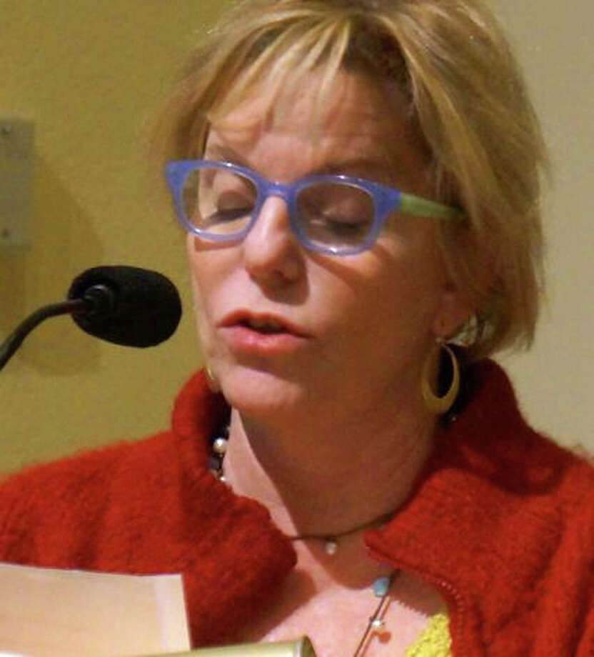 Liz Milwe, shown speaking at a Representative Town Meeting session last year, has been named to fill a vacant District 1 seat on the legislative body. Photo: File Photo / Westport News