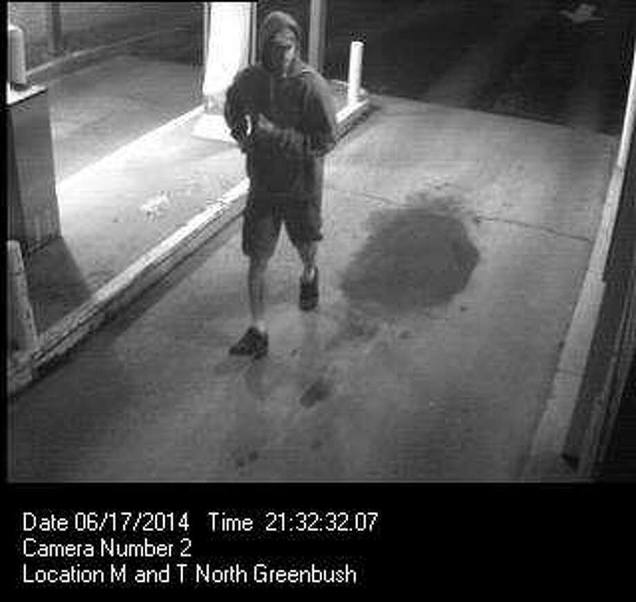 North Greenbush released this surveillance photo from a robbery at the M & T Bank on Route 4 on Tuesday June 17, 2014. (North Greenbush police photo)