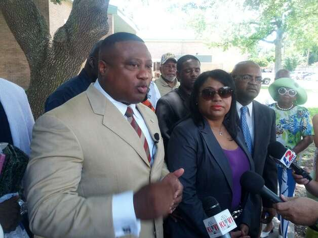 Quanell X, a Houston activist, protests the state takeover of the Beaumont school district and the firing of purchasing agent, Naomi Lawrence-Lee (right) on Wednesday.  Guiseppe Barranco/The Enterprise