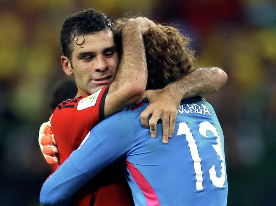 Man hugs are the best kind of hug there is. In honor of World Cup, we have compiled and defined the most epic man hugs because only soccer players seem to know how it's done.  Photo: Martin Mejia, Getty / AP